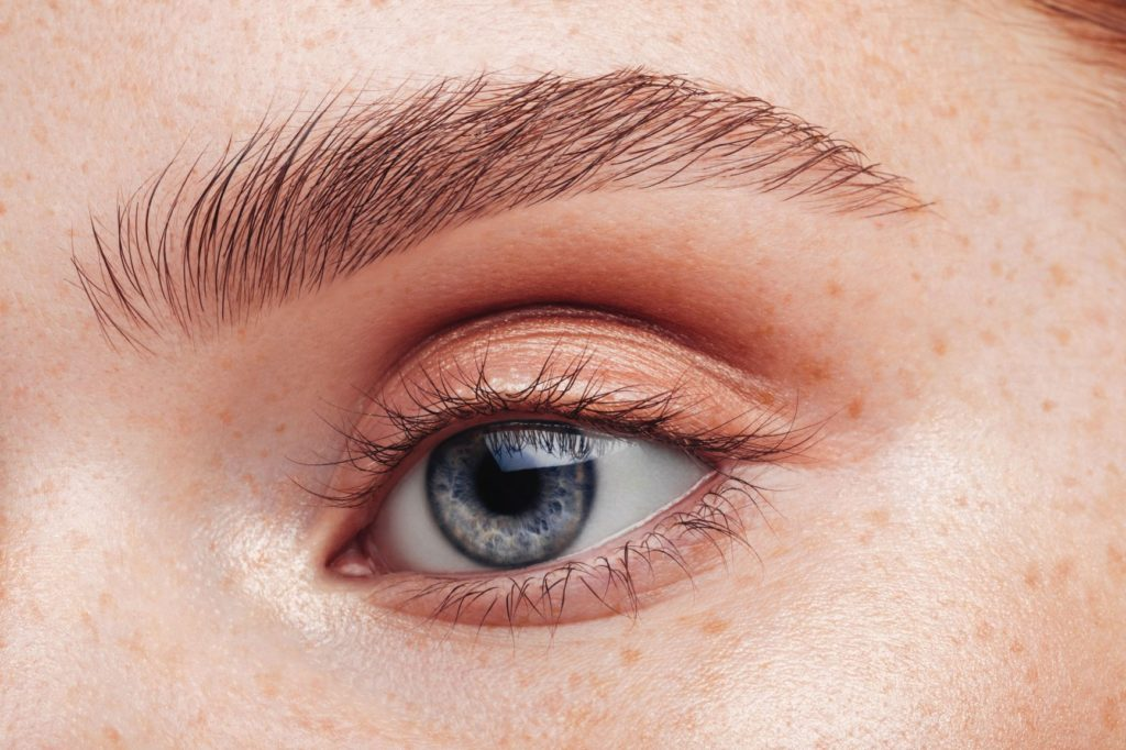 close up of womans eye and brow