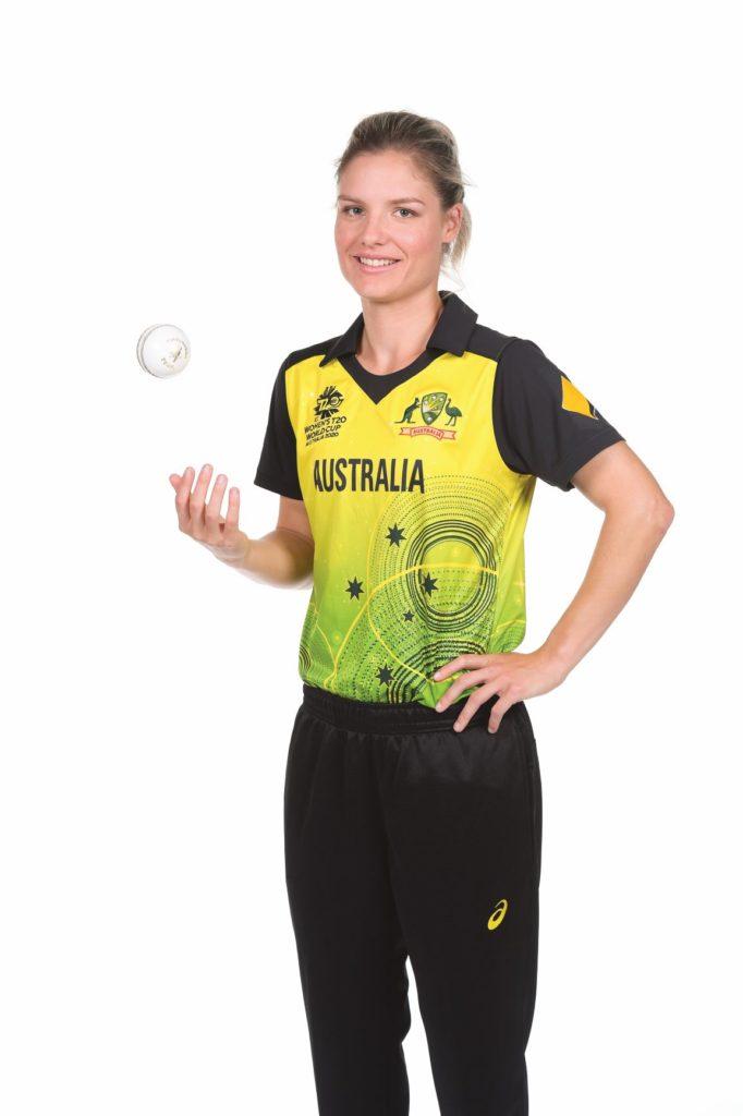 Nicola Carey holding a cricket ball