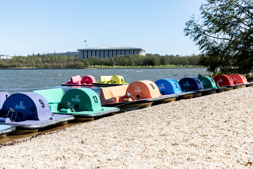 ACT Tourism operators paddleboats by the lake