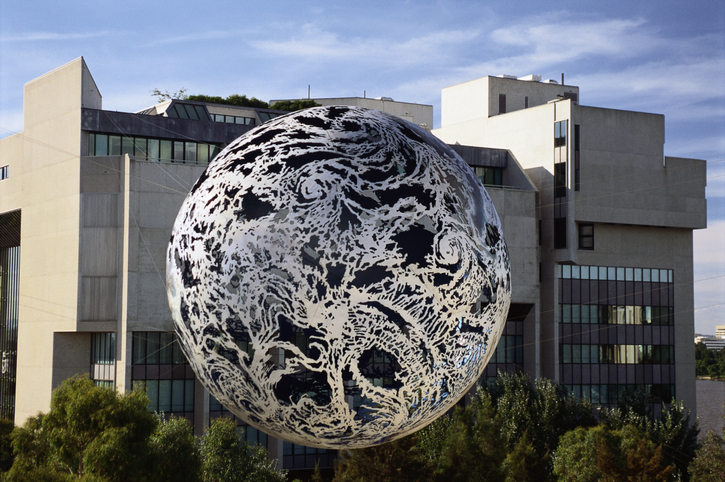 Globe sculpture by Neil Dawson suspended outside of the National Gallery of Australia building in Canberra