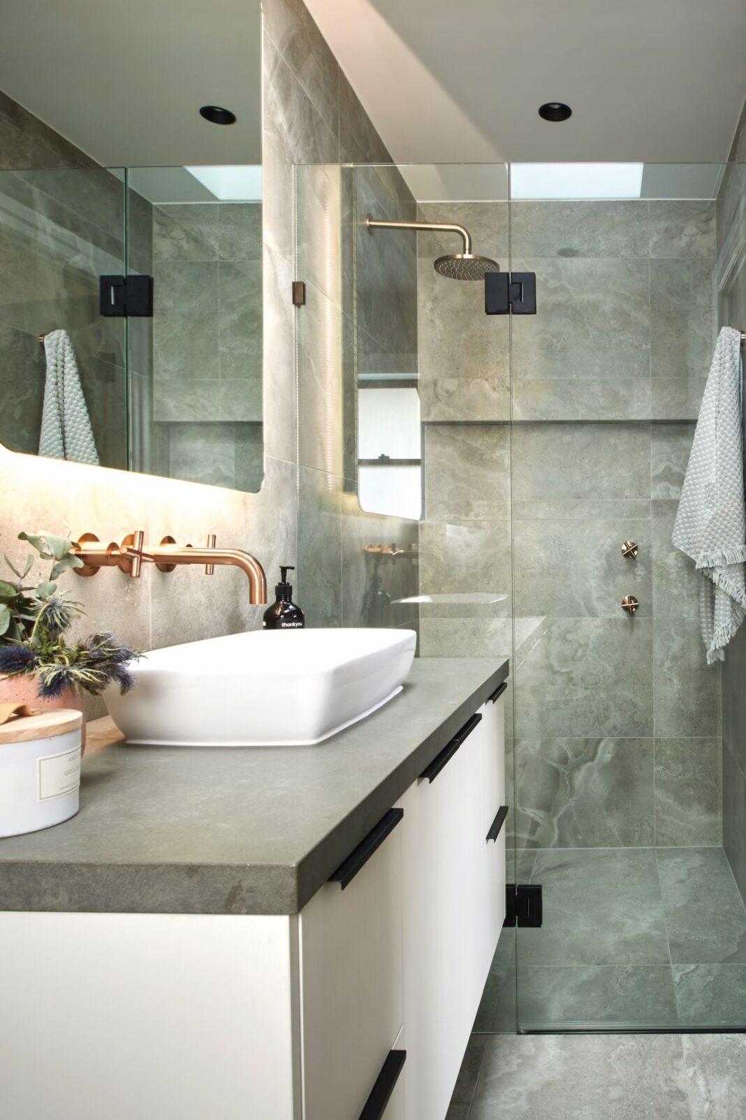 sleek bathroom with large mirror