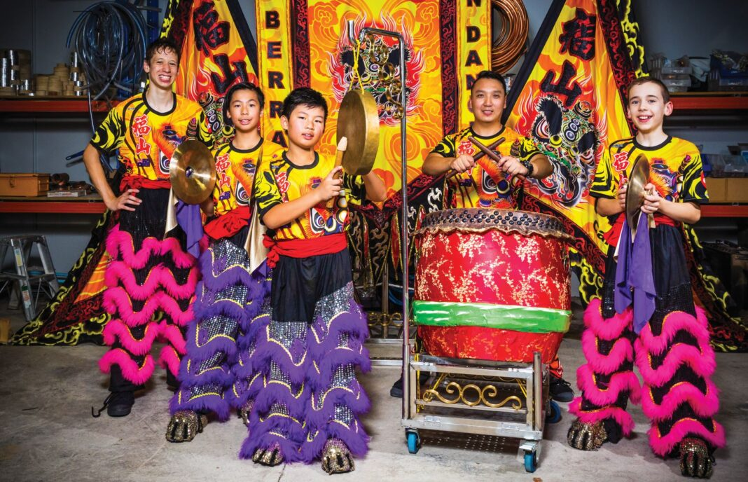 5 people in lion dancing costumes