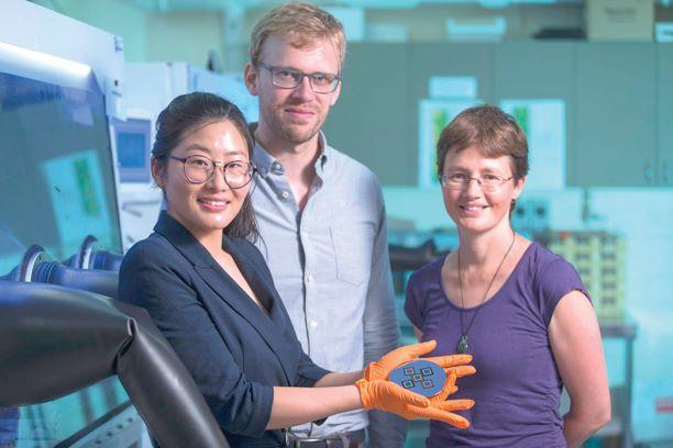 three people holding solar energy