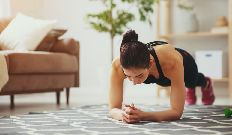 a young woman doing fitness and sports at home