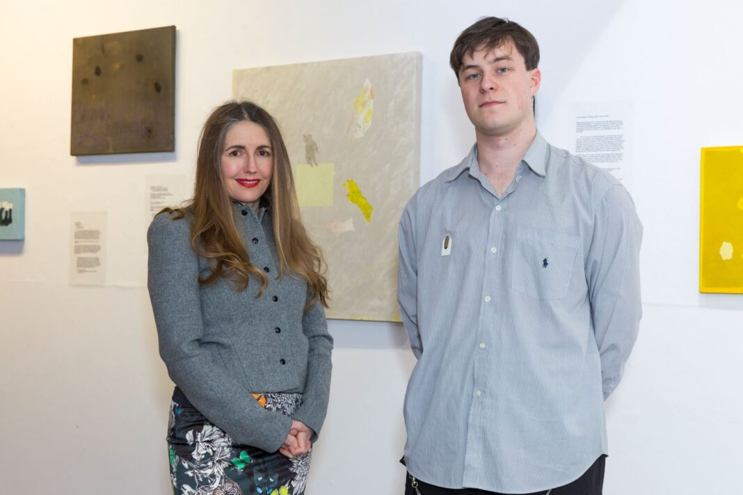 two people in art gallery
