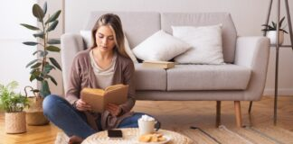woman sitting down reading a book