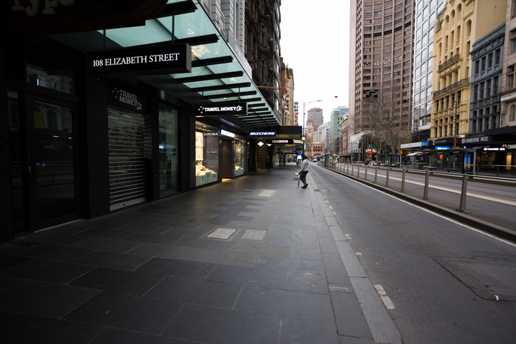 A view of Elizabeth Street with a single person visible during what would usually be peak hour during COVID-19 in Melbourne