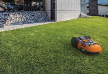 lawn mowing robot on a nice green lawn