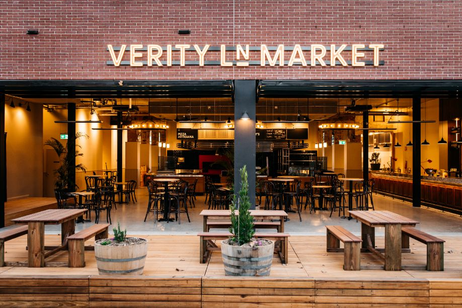 The front facade of Verity Lane Market food hall with outdoor seating