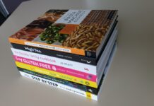 Stack of 7 cookbooks on a table