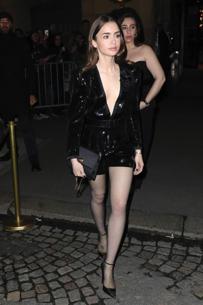 Lily Collins in a black outfit