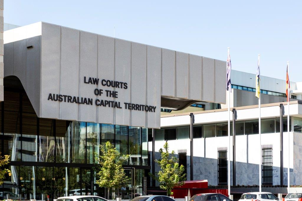 exterior of contemporary glass and white concrete building housing ACT law courts