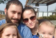 Young mum and dad with little girl and toddler boy with medical tube in his nose