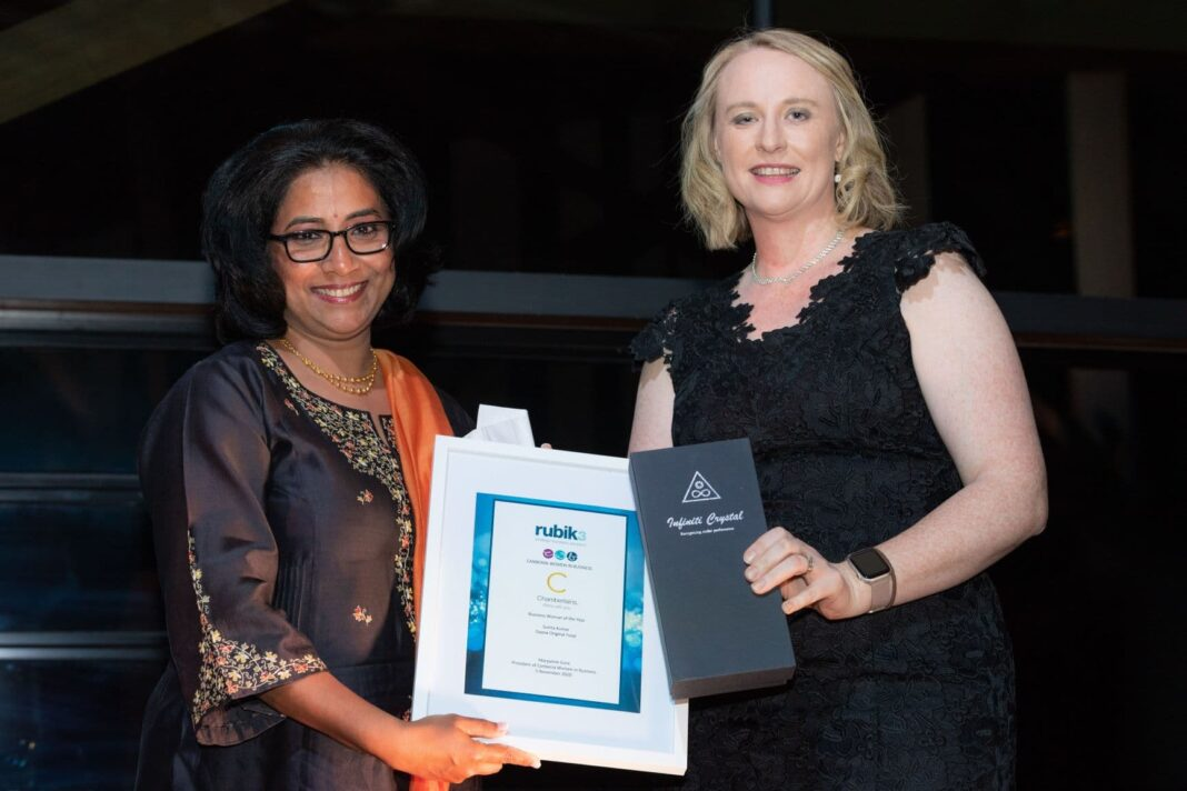 The CWB 2020 Business Woman of the Year, Sunita Kumar, accepts her award from Angela Backhouse