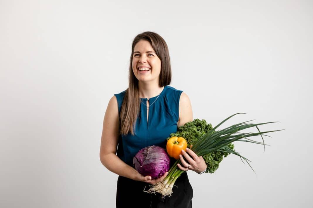 Kate Freeman holding fresh food