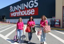 three women in pink out front of Bunnings