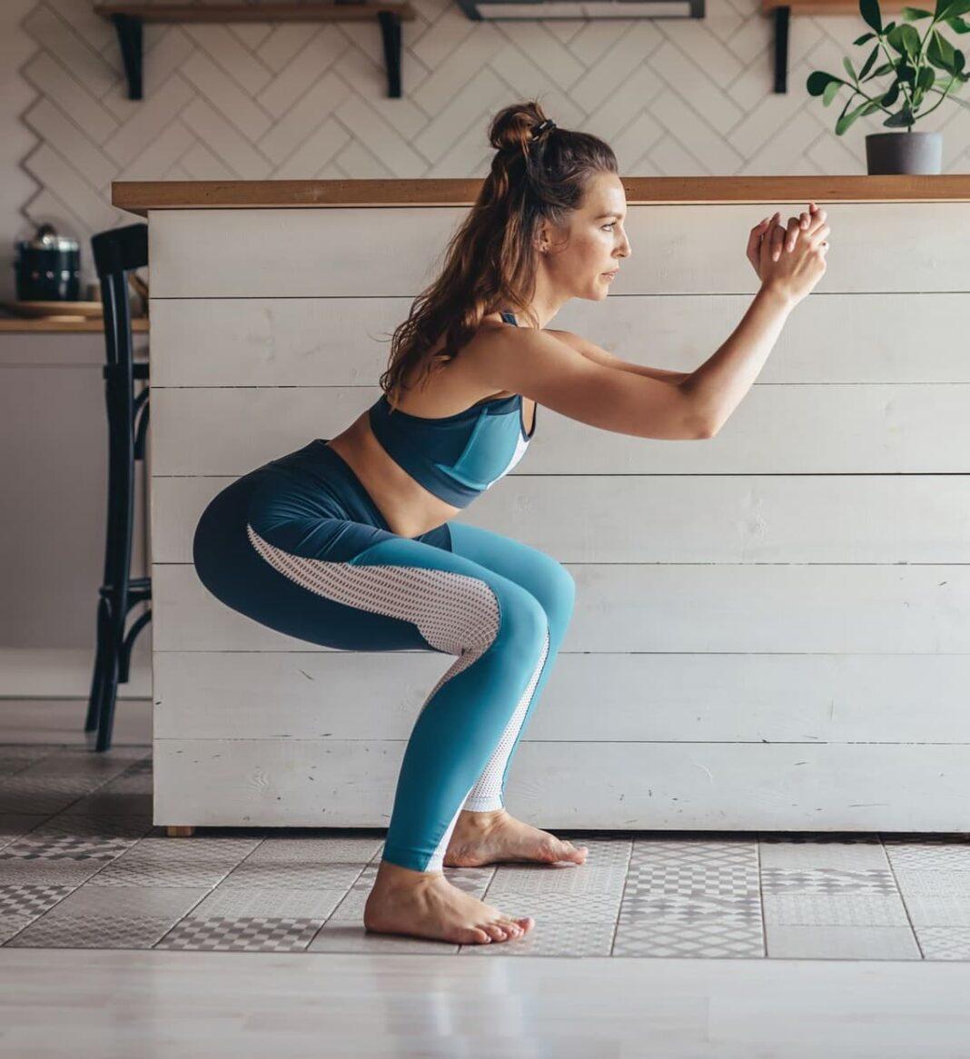 a woman doing a squat