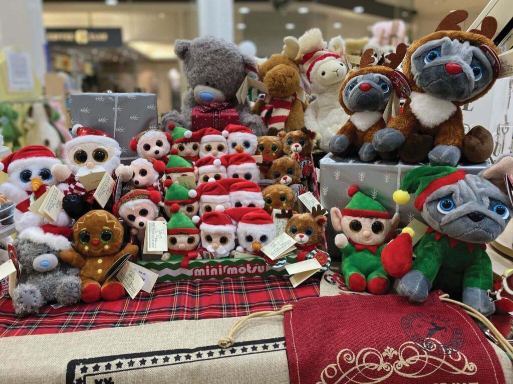 table full of stuffed christmas toys