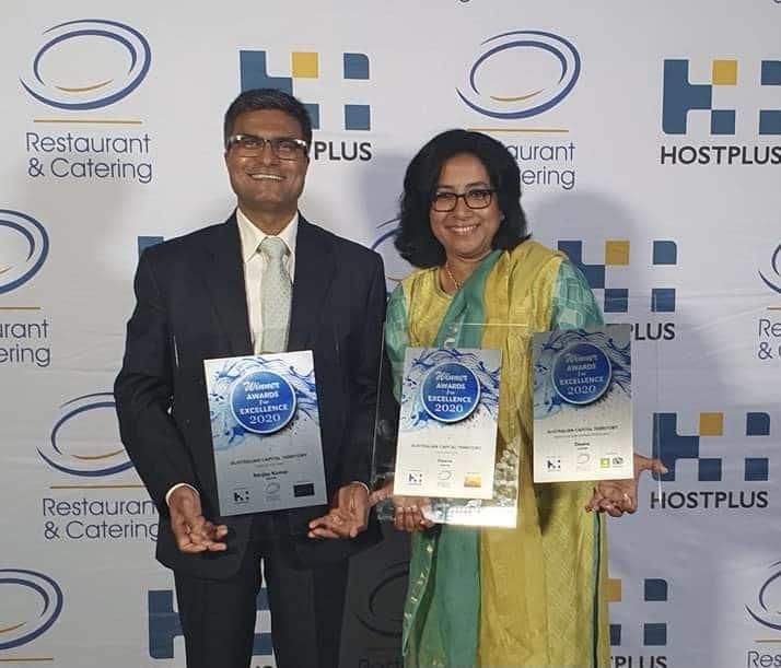 Image of Chefs Sanjay and Sunita Kumar with three R&CA Awards