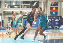 elite women's basketballers playing a match