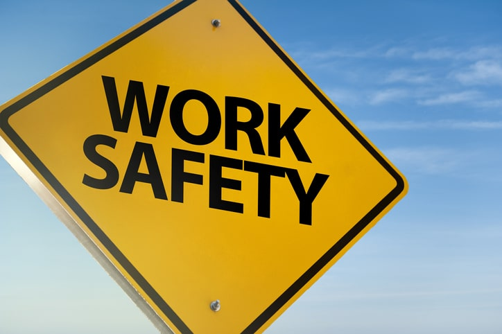 A yellow sign on a blue background that reads 'work safety'