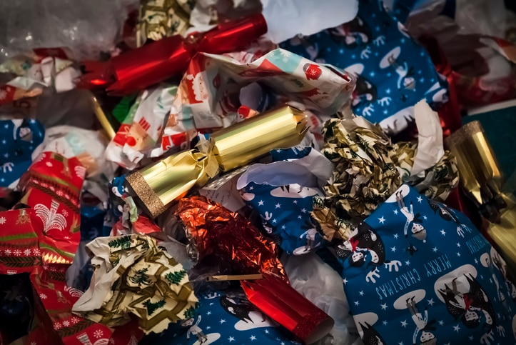 Pile of discarded Christmas wrapping paper, ribbon and bonbons