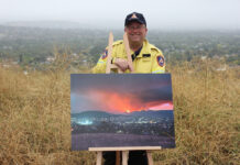 Gary Hooker with his photograph of the Orroral Valley fire
