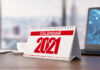 red and white 2021 Calendar at Office Desk