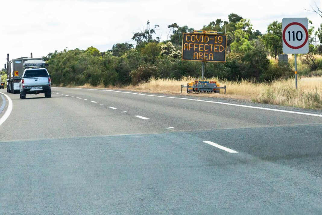 mobile roadside sign with covid notice