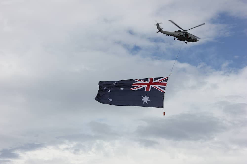 Australian flag flying under a helicopter