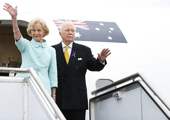 Governor General Quentin Bryce and Michael Bryce wave before boarding their plane during a departure ceremony at RAAF Fairburn on March 26, 2014 in Canberra.