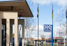 blue and white check police sign outside of police station in Canberra