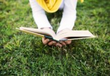 reading book on the grass