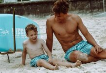 father and son in bondi joe swim trunks on the beach