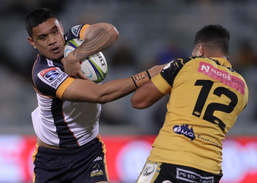 Brumbies player being tackled by Force player