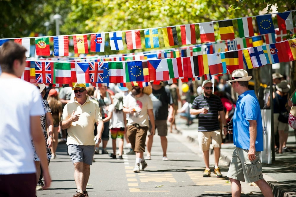Flags of the world hang across the footpath at a previous National Multicultural Festival