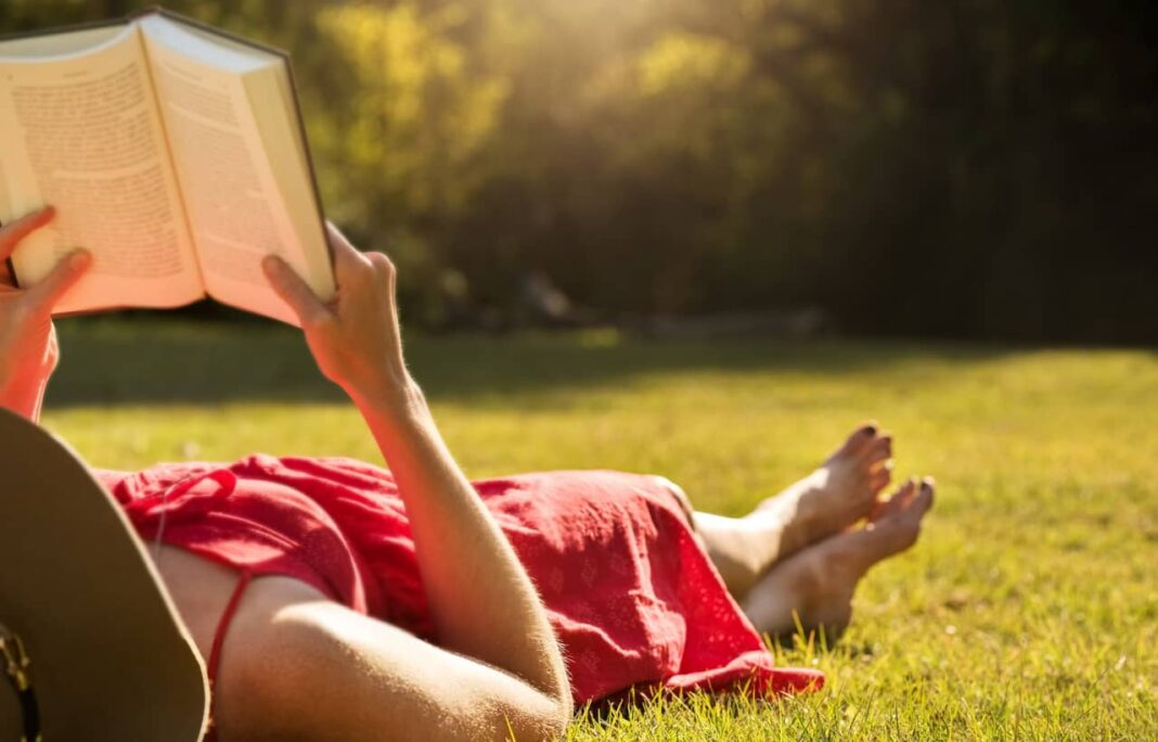 Woman reading on grass