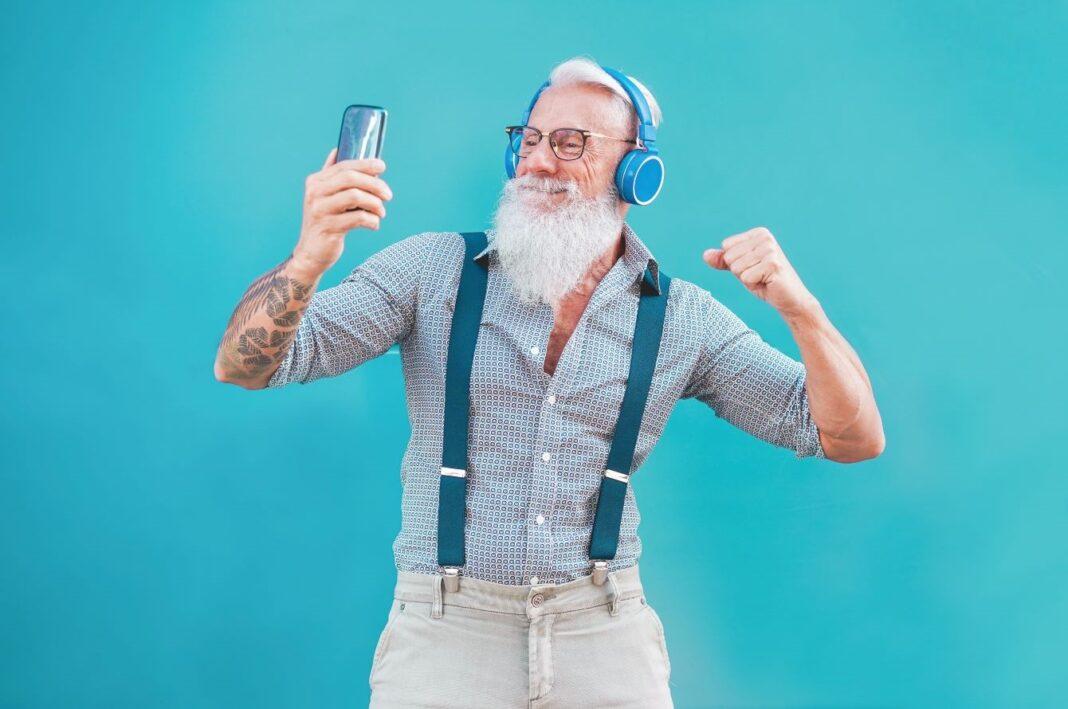 elderly man with headphones on dancing