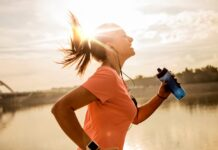 woman jogging with sun setting in background