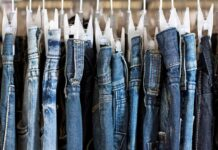 denim pants hanging on a rack