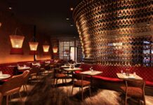 Stylish interior of trendy premium restaurant with mood lighting