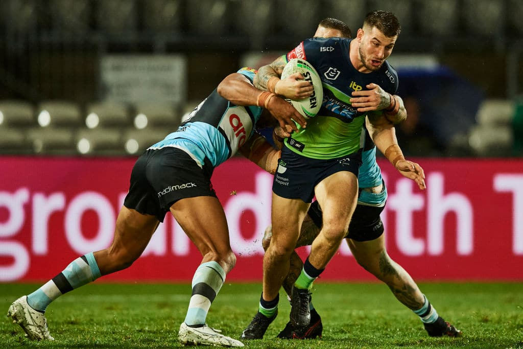 SYDNEY, AUSTRALIA - MARCH 21: Curtis Scott of the Raiders is tackled during the round two NRL match between the Cronulla Sharks and the Canberra Raiders at Netstrata Jubilee Stadium, on March 21, 2021, in Sydney, Australia. (Photo by Brett Hemmings/Getty Images)