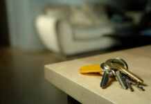 A set of keys on a kitchen bench serves as a visual for a story about housing stress and homelessness