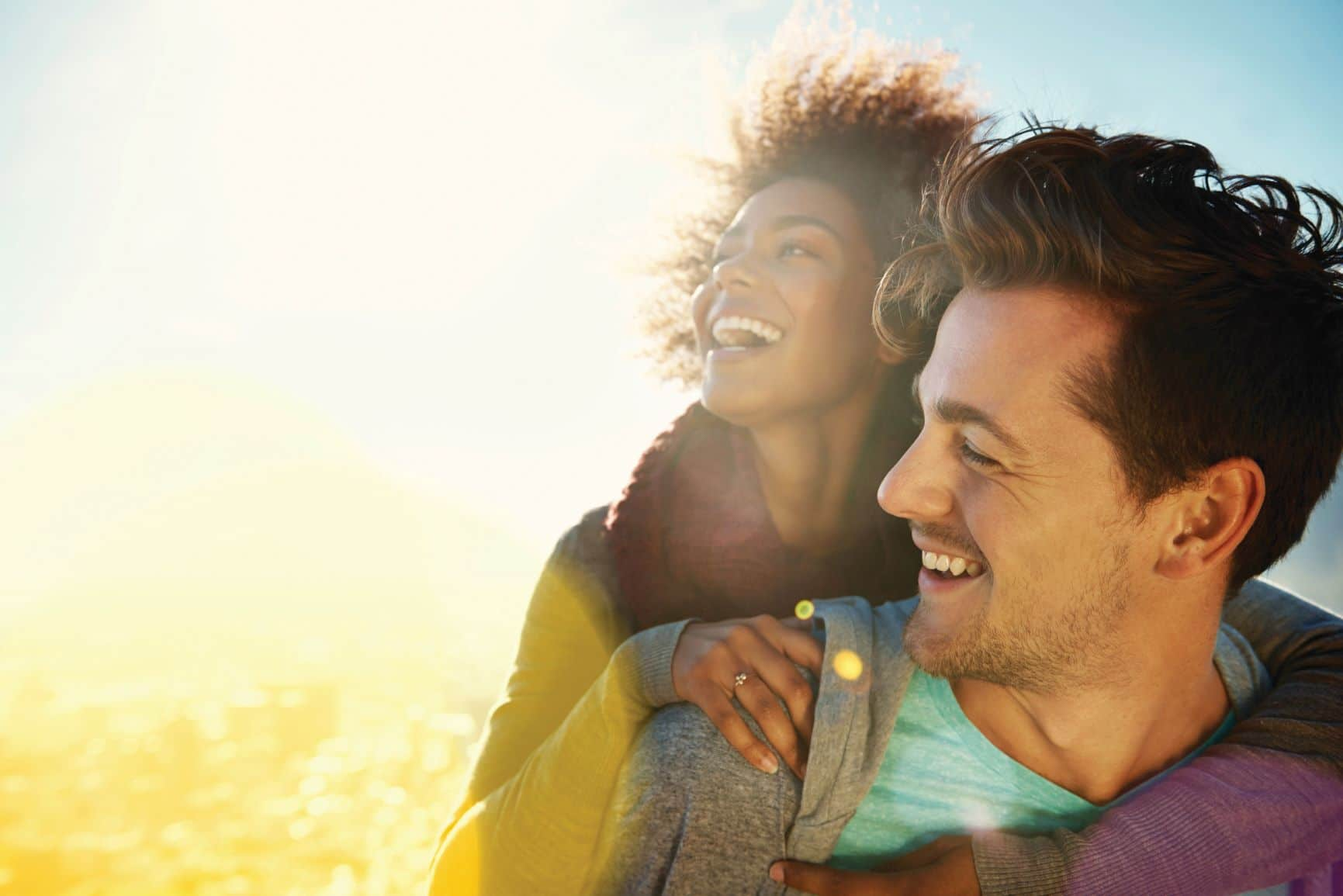 smiling couple in sunshine