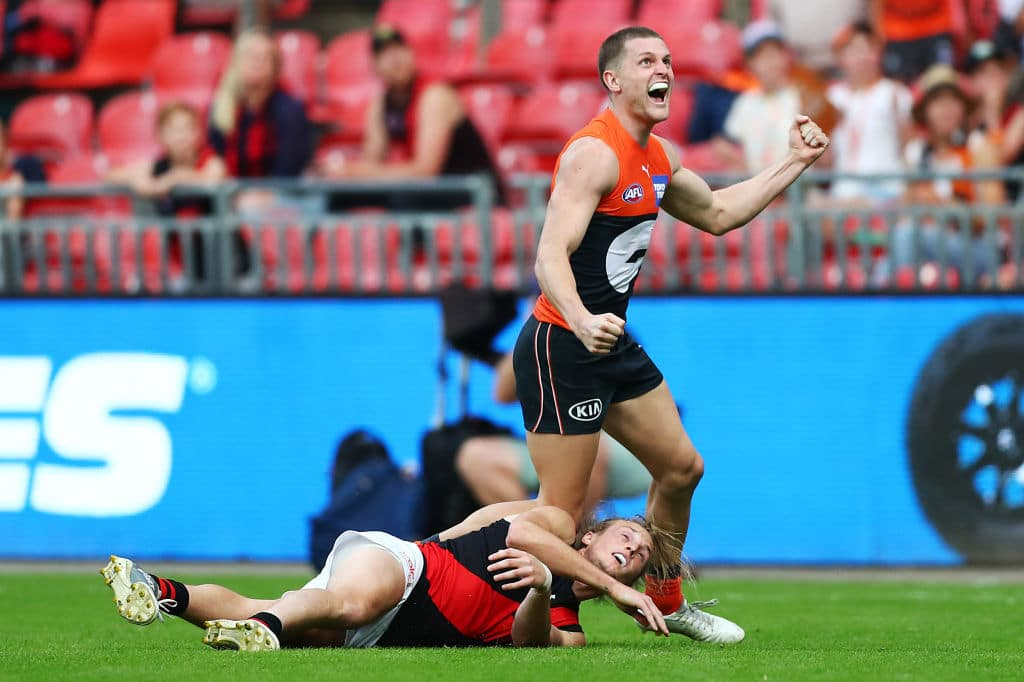 SYDNEY, AUSTRALIA - MAY 08: JacobHopper of the Giants celebrates kicking the winning goal during the round eight AFL match between the Greater Western Sydney Giants and the Essendon Bombers at GIANTS Stadium on May 08, 2021 in Sydney, Australia. (Photo by Mark Metcalfe/AFL Photos via Getty Images)