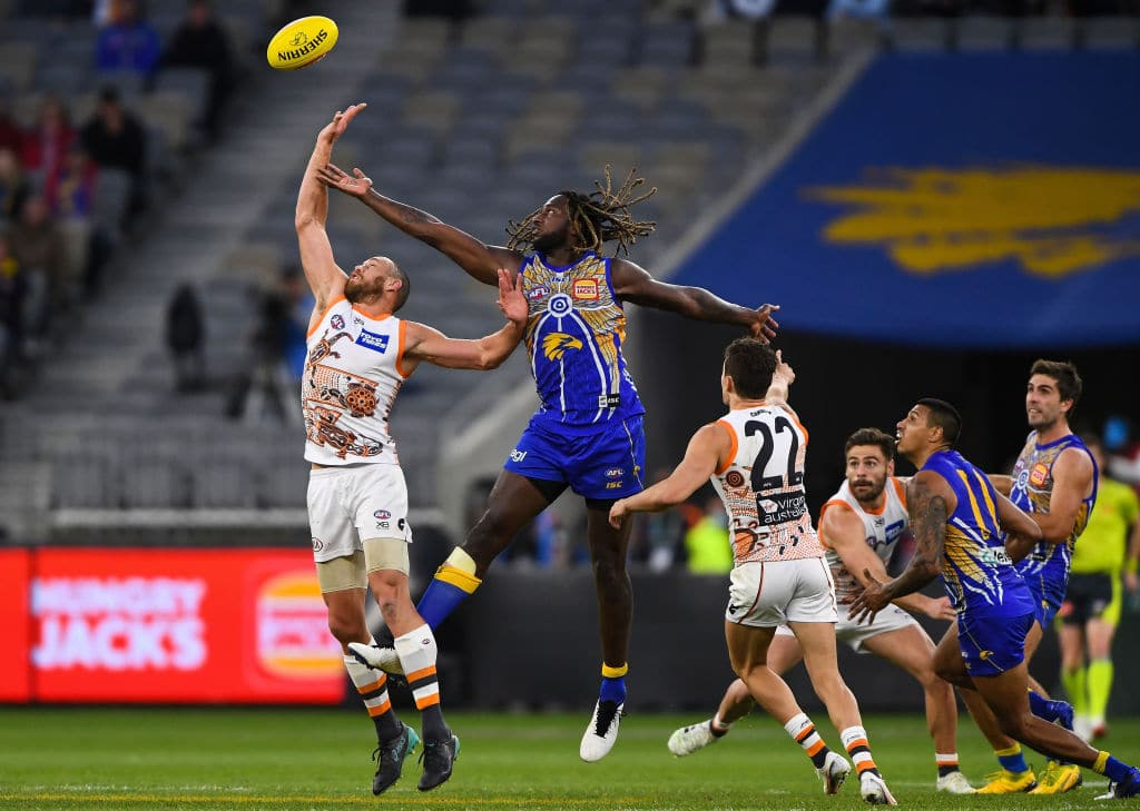 PERTH, AUSTRALIA - AUGUST 23: Shane Mumford of the Giants competes in a ruck contest with Nic Naitanui of the Eagles during the 2020 AFL Round 13 match between the West Coast Eagles and the GWS Giants at Optus Stadium on August 23, 2020 in Perth, Australia. (Photo by Daniel Carson/AFL Photos via Getty Images)